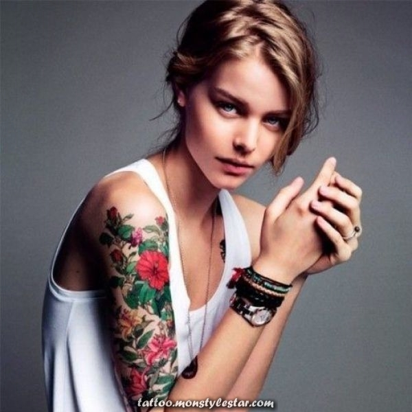 Upper arm tattoo for women with flower pattern - HypeFeed