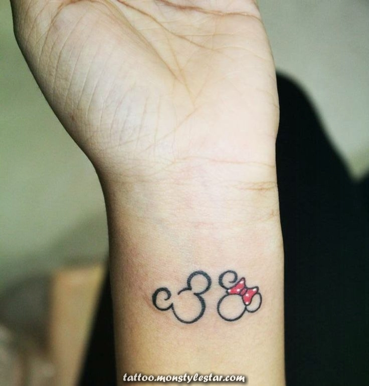 tattoos-mickey-mouse-minnie-bow-red-arm-tattoo - Lord Gimmel